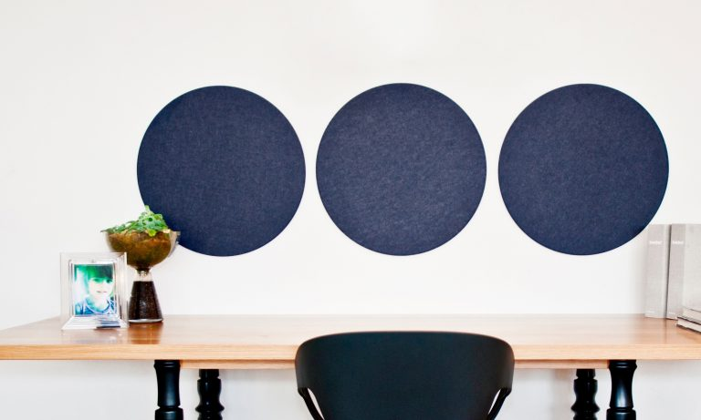 round navy pinboards in situ